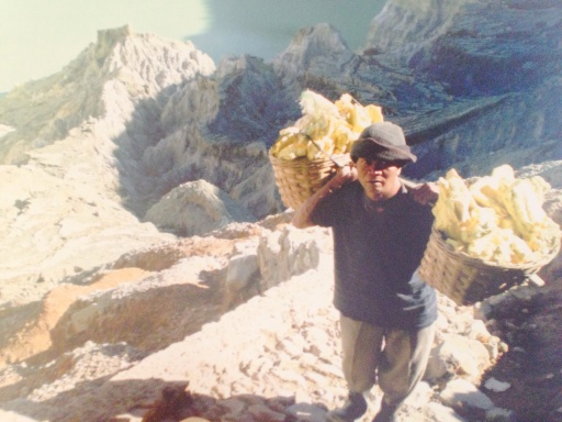 Miner carrying his load of sulphur up the crater